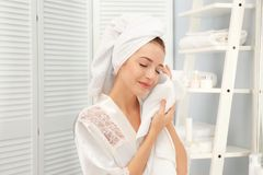 Young woman wiping her face with towel Royalty Free Stock Images