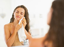 Young woman wiping with towel in bathroom. Young pretty woman wiping with towel in modern bathroom Royalty Free Stock Photography
