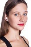 Young woman with wireless earphones. Wireless earphones on human hands. studio shot Stock Image