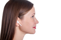 Young woman with wireless earphones. Wireless earphones on human hands. studio shot Stock Photo
