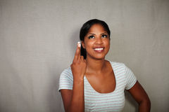 Young woman wishing with fingers crossed Stock Photo
