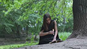 Young woman in witch costume stock footage