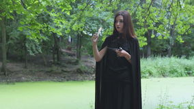 Young woman in witch costume stock video