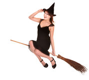 Young woman witch fly on  broom. Stock Images