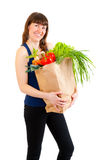 Young Woman With A Full Grocery Bag Stock Photo