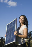 Young Woman With A Solar Panel Stock Images
