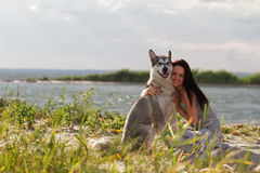 Young Woman With Alaskan Malamute Dog Stock Images