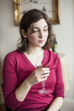 Young Woman With Beautiful Green Eyes Drinking Wine Stock Image