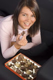 Young Woman With Box Of Chocolates Royalty Free Stock Photos