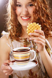 Young Woman With Coffee And Cookies Stock Photography