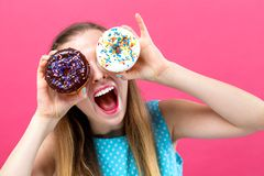 Free Young Woman With Donuts Royalty Free Stock Image - 130077436