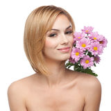 Young Woman With Flowers Next To Her Face Royalty Free Stock Photography