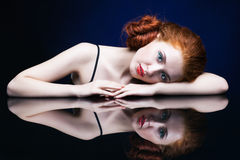Free Young Woman With Ginger Hair Over Reflection Mirror On Blue Back Stock Photo - 78197550