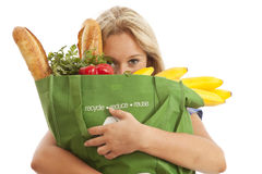 Young Woman With Green Recycled Grocery Bag Stock Photography