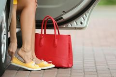 Free Young Woman With Pain In Legs Because Of Uncomfortable Shoes Sitting In Car Royalty Free Stock Photo - 151203285