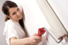 Young Woman With Painting Roller Stock Photo