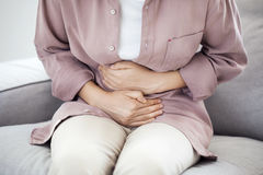 Free Young Woman With Stomach Pain Stock Photo - 97023080