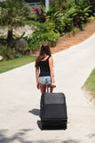 Young Woman With Suitcase Stock Images