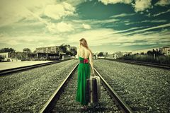 Free Young Woman With Suitcase Walking Away On Rail Tracks Royalty Free Stock Photo - 50196785