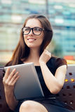 Young Woman With Tablet Out In The City Stock Photography