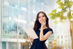 Young Woman With Tablet Out In The City Stock Photos