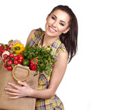 Young Woman With Vegetables And Fruits In Shopping Bag