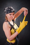Young Woman With Yellow Gloves Stock Images