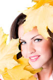 Young Woman With Yellow Leaves Royalty Free Stock Image