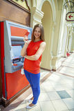Young woman withdrawing money from credit card at ATM Royalty Free Stock Photography