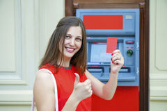 Young woman withdrawing money from credit card at ATM Royalty Free Stock Photo