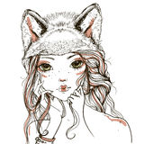 Young woman with wolf headdress Royalty Free Stock Image