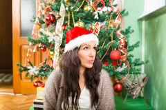 Young woman wondering about Christmas presents and New Year gift Royalty Free Stock Photography