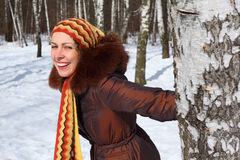 Young woman in wood keeps for birch Stock Photography