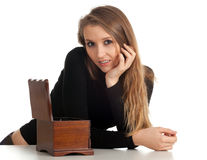 Young woman with wooden jewelry box Royalty Free Stock Image