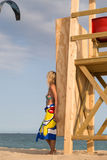 Young woman on the wooden rescue tower. Stock Photo