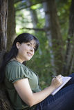 Young Woman in Woods Stock Photo