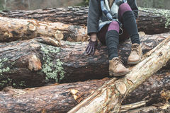 Young woman on woods. Young woman on wood logs Stock Image