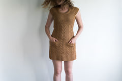 Young woman in a woolen dress Royalty Free Stock Photography