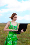 Young woman work on the notebook outdoors Royalty Free Stock Photo