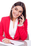 Young woman at work, smiling to your mobile Stock Photo