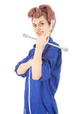 Young woman worker in blue coveralls with tool Royalty Free Stock Photos