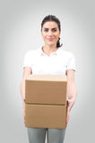 Young woman worker holding boxes Stock Images