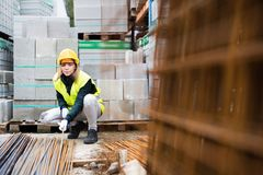 Young woman worker in an industrial area. Stock Photos