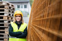 Young woman worker in an industrial area. Stock Photo