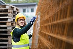 Young woman worker in an industrial area. stock images