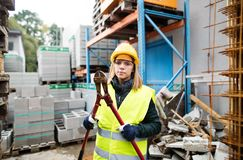 Young woman worker with large bolt cutters. Stock Photo