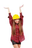 Young woman worker in red shirt and yellow helmet with raised ha Royalty Free Stock Photos