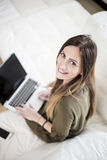 Young woman workin at home Royalty Free Stock Photo