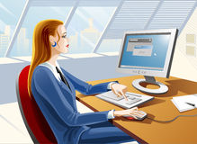 Young woman working. By the computer Royalty Free Stock Photo