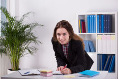 Young woman working in agency Stock Photo